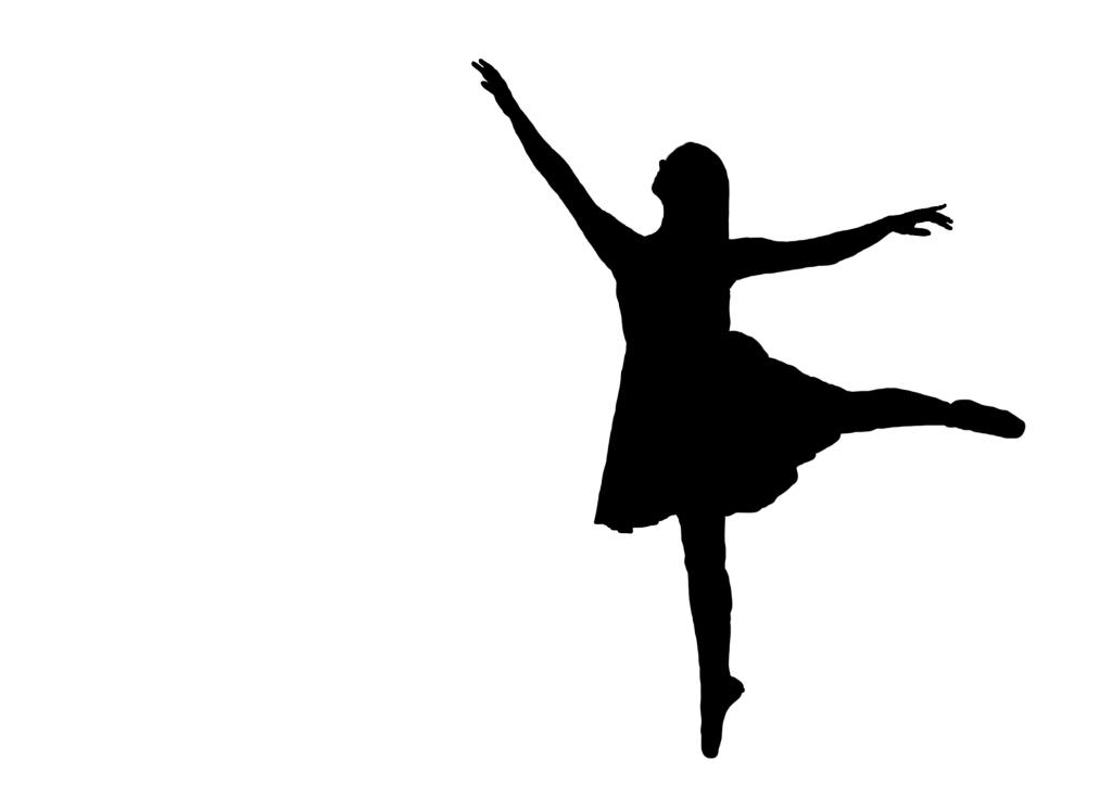 Silhouette of dancer on pointe in arabesque