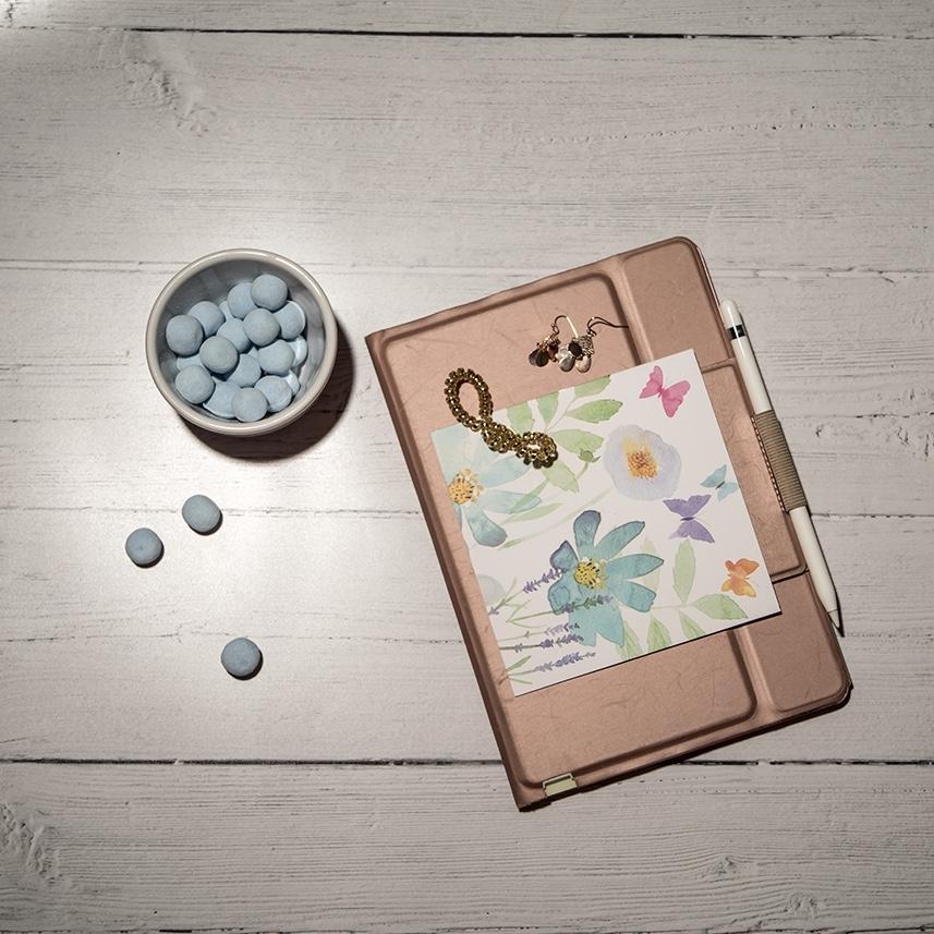 iPad, notecard and sweets