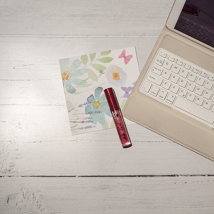 Kick start your self care routine - laptop and lip gloss