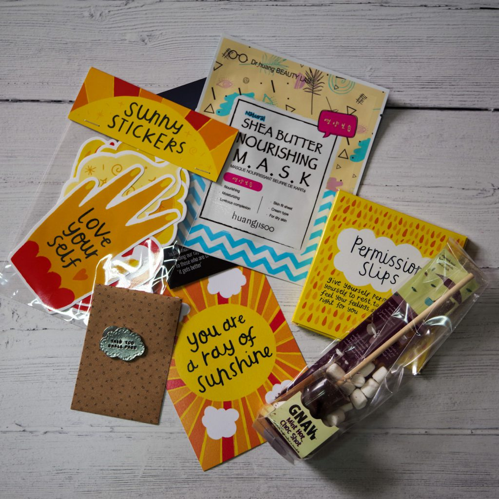 Buddy box review - photo shows flat-lay of the contents of a Buddy Box, wellbeing subscription box